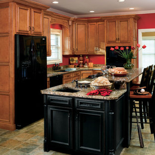 This is an example of a mid-sized traditional l-shaped separate kitchen in Other with an undermount sink, recessed-panel cabinets, medium wood cabinets, granite benchtops, black appliances, slate floors, with island, green floor and beige benchtop.