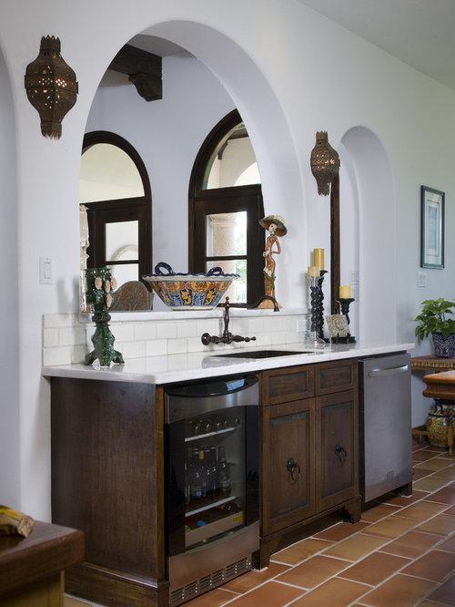 Tuscan Kitchen Photo In Houston With An Undermount Sink Raised Panel Cabinets Dark