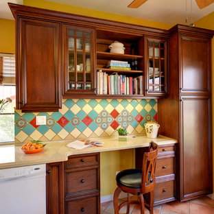 Design ideas for a mediterranean galley separate kitchen in San Diego with recessed-panel cabinets, medium wood cabinets, quartz benchtops, green splashback, ceramic splashback, terra-cotta floors, pink floor and beige benchtop.
