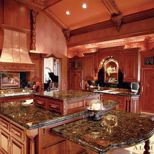 Large traditional l-shaped separate kitchen in Orange County with raised-panel cabinets, medium wood cabinets, granite benchtops, black splashback, ceramic splashback, panelled appliances, ceramic floors and with island.