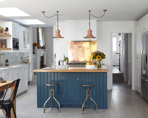 Example Of An Urban Eat In Kitchen Design In London With An Undermount Sink,