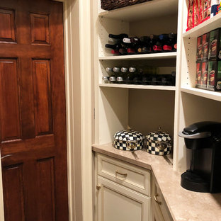 Small traditional kitchen pantry in New York with recessed-panel cabinets, white cabinets, laminate benchtops, ceramic floors, beige floor and beige benchtop.