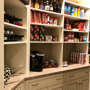 Inspiration for a small traditional kitchen pantry in New York with recessed-panel cabinets, white cabinets, laminate benchtops, ceramic floors, beige floor and beige benchtop.