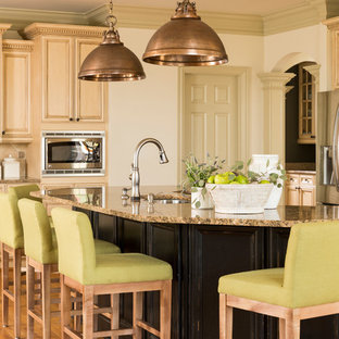 Design ideas for a large traditional kitchen in Atlanta with beige cabinets, granite worktops, an island, a submerged sink, recessed-panel cabinets, stainless steel appliances and medium hardwood flooring.