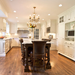 Traditional kitchen pictures - Inspiration for a timeless kitchen remodel in DC Metro with beaded inset cabinets, white cabinets, white backsplash and stone slab backsplash