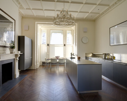 Example Of A Trendy Dark Wood Floor Kitchen Design In London With  Flat Panel Cabinets