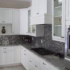 Natural Oak Cabinets With Glass Mosaic Backsplash