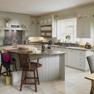 Inspiration for a mid-sized timeless l-shaped beige floor eat-in kitchen remodel in Wiltshire with gray cabinets, granite countertops, black backsplash, an island, a double-bowl sink and shaker cabinets