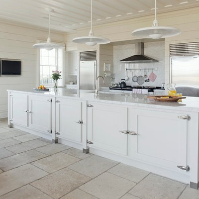 Inspiration for a timeless eat-in kitchen remodel in Wiltshire with an undermount sink, white cabinets, white backsplash, stone slab backsplash and stainless steel appliances