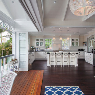 Inspiration for a large beach style u-shaped eat-in kitchen remodel in Brisbane with recessed-panel cabinets, white cabinets and an island