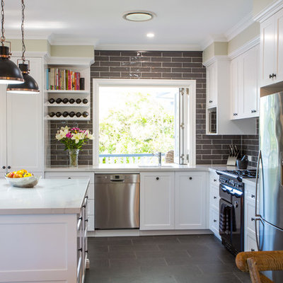 Inspiration for a large timeless l-shaped ceramic tile and gray floor open concept kitchen remodel in Brisbane with an undermount sink, shaker cabinets, white cabinets, quartz countertops, gray backsplash, black appliances and an island