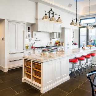 Design ideas for an expansive traditional galley kitchen in Melbourne with a farmhouse sink, white cabinets, granite benchtops, white splashback, with island, subway tile splashback, shaker cabinets, stainless steel appliances, porcelain floors, grey floor and multi-coloured benchtop.