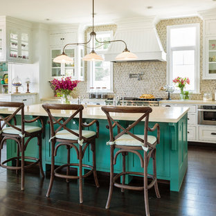 This is an example of a large traditional open plan kitchen in Los Angeles with an undermount sink, shaker cabinets, turquoise cabinets, beige splashback, mosaic tile splashback, stainless steel appliances, dark hardwood floors, with island and brown floor.