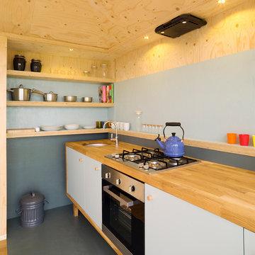 Hand-built kitchen with oakstrip worktop.