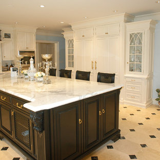 Elegant kitchen photo in New York with glass-front cabinets and stainless steel appliances