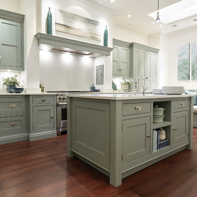 Kitchen - large transitional u-shaped dark wood floor and brown floor kitchen idea in London with shaker cabinets, green cabinets, quartzite countertops, white backsplash, stainless steel appliances, an island and white countertops