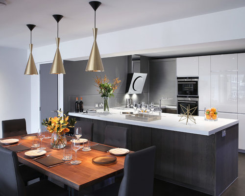 This Is An Example Of A Contemporary Kitchen/diner In London With Flat Panel