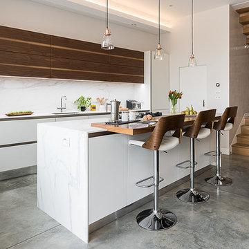 Handles kitchen in white matt finish with walnut veneer bookmatch wall cabinets