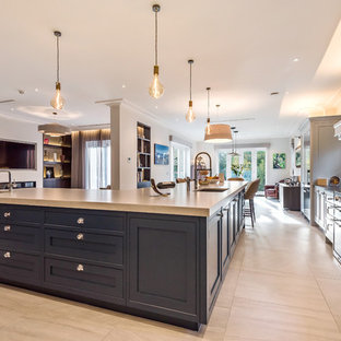 Design ideas for a large transitional l-shaped open plan kitchen in Berkshire with an undermount sink, shaker cabinets, stainless steel appliances, grey cabinets, quartzite benchtops, blue splashback, marble splashback, marble floors, with island, beige floor and white benchtop.