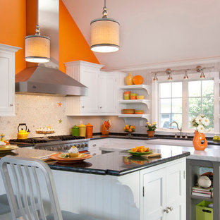 Large country u-shaped eat-in kitchen in Other with a farmhouse sink, white cabinets, marble benchtops, white splashback, glass tile splashback, coloured appliances, ceramic floors, with island, recessed-panel cabinets and grey floor.