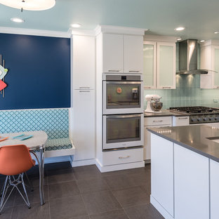 Large modern eat-in kitchen ideas - Example of a large minimalist l-shaped eat-in kitchen design in St Louis with an undermount sink, flat-panel cabinets, white cabinets, quartz countertops, blue backsplash, glass tile backsplash and a peninsula
