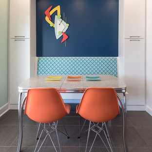 Eat-in kitchen - eclectic eat-in kitchen idea in St Louis with flat-panel cabinets, blue backsplash and white cabinets