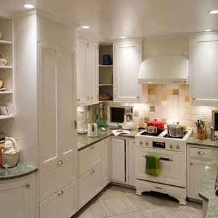 Inspiration for a small beach style u-shaped separate kitchen in Chicago with a double-bowl sink, recessed-panel cabinets, white cabinets, laminate benchtops, beige splashback, ceramic splashback, white appliances, porcelain floors, no island and beige floor.