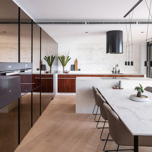Inspiration for a small contemporary galley eat-in kitchen in Sydney with an undermount sink, flat-panel cabinets, marble benchtops, white splashback, marble splashback, light hardwood floors, with island, white benchtop, dark wood cabinets and brown floor.