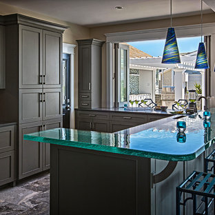 Beach style eat-in kitchen ideas - Inspiration for a beach style u-shaped marble floor eat-in kitchen remodel in Philadelphia with shaker cabinets, green cabinets, glass countertops and turquoise countertops