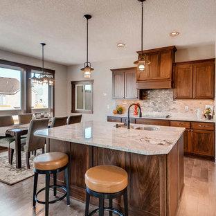 Mittelgroße Rustikale Küche mit Teppichboden, grauem Boden, dunklen Holzschränken, Granit-Arbeitsplatte, Küchenrückwand in Weiß, Rückwand aus Keramikfliesen, Küchengeräten aus Edelstahl, Kücheninsel und weißer Arbeitsplatte in Minneapolis