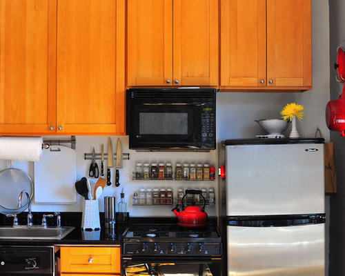 Example Of An Eclectic Single Wall Kitchen Design In New York With A Drop