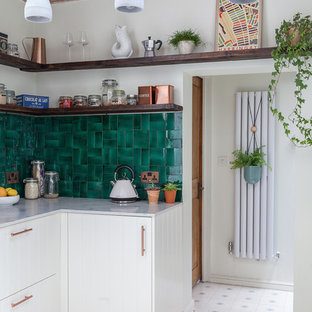 Small eclectic l-shaped separate kitchen in London with an integrated sink, shaker cabinets, white cabinets, marble benchtops, green splashback, ceramic splashback, panelled appliances, cement tiles, no island and white floor.