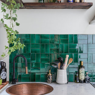 Inspiration for a small eclectic l-shaped separate kitchen in London with white cabinets, marble benchtops, green splashback, ceramic splashback, no island, a drop-in sink and louvered cabinets.
