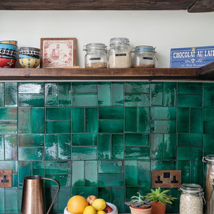 Inspiration for a small bohemian l-shaped enclosed kitchen in London with an integrated sink, shaker cabinets, white cabinets, marble worktops, green splashback, ceramic splashback, integrated appliances, cement flooring, no island and white floors.