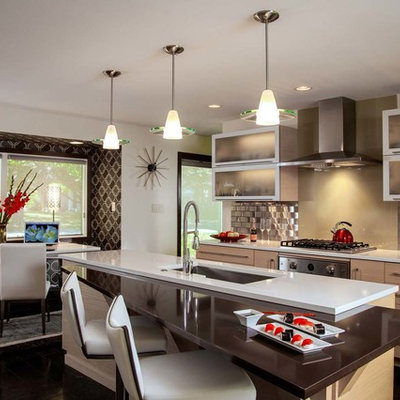 Example of a small trendy galley ceramic tile eat-in kitchen design in Other with an undermount sink, flat-panel cabinets, light wood cabinets, metallic backsplash, metal backsplash, an island, quartz countertops and stainless steel appliances