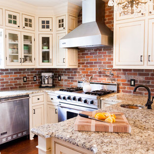 Huge farmhouse eat-in kitchen photos - Eat-in kitchen - huge country u-shaped medium tone wood floor eat-in kitchen idea in New York with white cabinets, granite countertops, a farmhouse sink, red backsplash, stainless steel appliances, no island, beaded inset cabinets and brick backsplash