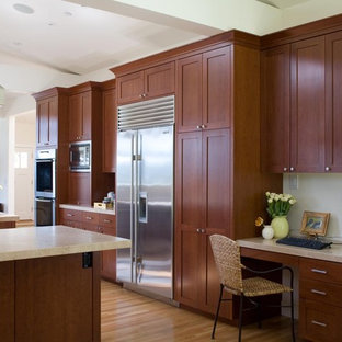 Example of a trendy kitchen design in San Francisco with limestone countertops, stainless steel appliances, shaker cabinets and dark wood cabinets
