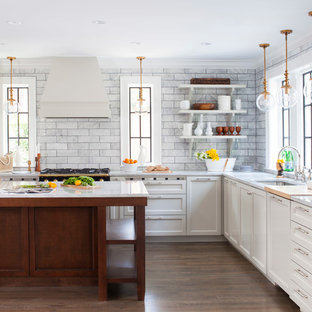 Example of a mid-sized transitional l-shaped medium tone wood floor open concept kitchen design in Atlanta with an undermount sink, recessed-panel cabinets, gray cabinets, marble countertops, white backsplash, black appliances, an island and marble backsplash