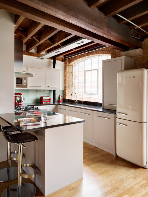 small eclectic kitchen remodeling example of a small eclectic u shaped light wood floor - Glass Sheet Kitchen Design