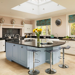 Kitchen - traditional l-shaped kitchen idea in London with an island