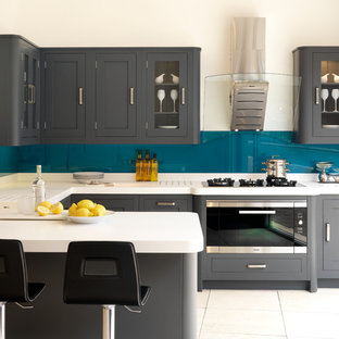 inspiration for a transitional u shaped kitchen remodel in london with an integrated sink - Teal Kitchen Cabinets