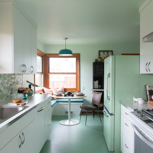 Design ideas for a small midcentury galley eat-in kitchen in Portland with a drop-in sink, flat-panel cabinets, white cabinets, laminate benchtops, multi-coloured splashback, ceramic splashback, coloured appliances, linoleum floors, no island, green floor and white benchtop.