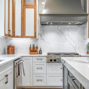 Inspiration for a large midcentury eat-in kitchen in Atlanta with a drop-in sink, shaker cabinets, white cabinets, quartz benchtops, white splashback, stainless steel appliances, ceramic floors, with island, beige floor and white benchtop.