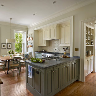 Elegant eat-in kitchen photo in Philadelphia with a double-bowl sink, soapstone countertops, white backsplash, subway tile backsplash, raised-panel cabinets and green cabinets