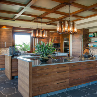 Tropical kitchen remodeling - Inspiration for a tropical kitchen remodel in Vancouver with paneled appliances