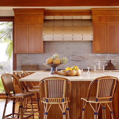 Eat-in kitchen - large tropical l-shaped medium tone wood floor eat-in kitchen idea in Hawaii with medium tone wood cabinets, gray backsplash, subway tile backsplash, an undermount sink, recessed-panel cabinets, marble countertops and an island