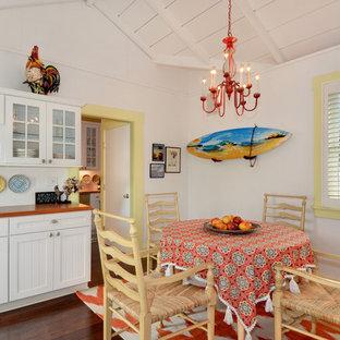 Inspiration pour une cuisine américaine ethnique avec un sol en bois foncé, un placard à porte affleurante, des portes de placard blanches et aucun îlot.