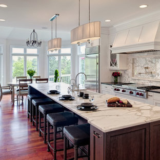 Transitional eat-in kitchen photos - Eat-in kitchen - transitional eat-in kitchen idea in Chicago with white cabinets, marble countertops, stainless steel appliances, a farmhouse sink and recessed-panel cabinets