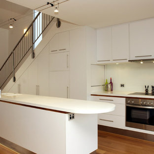Contemporary kitchen pictures - Inspiration for a contemporary kitchen remodel in Adelaide with flat-panel cabinets and white cabinets