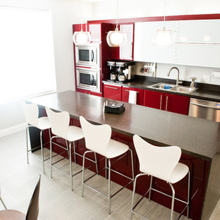 Inspiration for a contemporary single-wall kitchen/diner in Tampa with a built-in sink, flat-panel cabinets, red cabinets and stainless steel appliances.